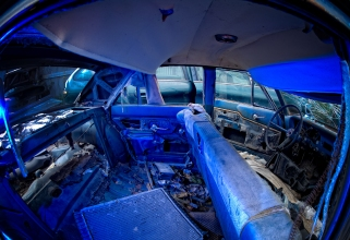 The off-camera flash was filtered blue and a fish-eye lens adds even more drama. (Nikkor 16mm f2.8)